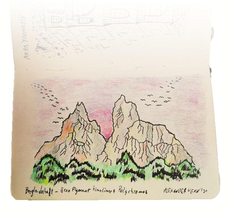 Bunte Berglandschaft mit Polychomos Buntstiften im Skizzenbuch